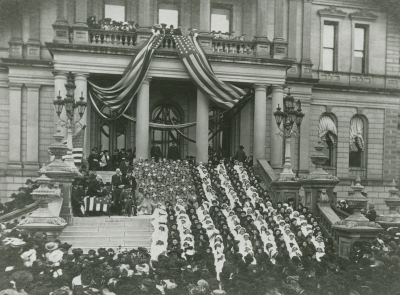 A living flag on the Capitol's steps on Memorial Day, 1904.  Admiral George Dewey, hero of the Spanish-American war, is visible on the left.