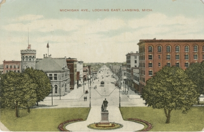 A view of Capitol Square looking eastward c. 1910. Note the colorful flower beds and the M shaped lighting fixture